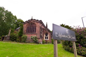 Edgbaston Old Church. The church's name is picked out on a sign which also bears the Church of England's logo.
