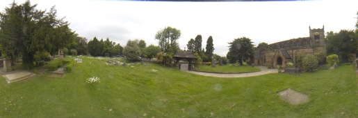 Panoramic view of the graveyard at Edgbaston Old Church including the lychgate over the entrance.