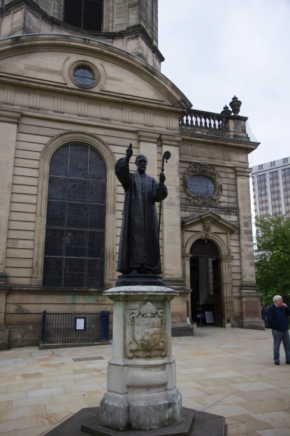 """Memorial statue to Charles Gore the first Bishop of Birmingham, """"enthroned"""" in 1905."""