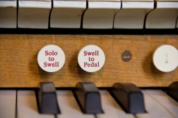 A close up of some of the buttons and keys on the console that the organist uses to play the organ at St. Philips' Cathedral, Birmingham.
