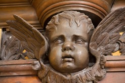 This is one of several cherubs that decorates the casing of the organ at St. Philips' Cathedral, Birmingham.