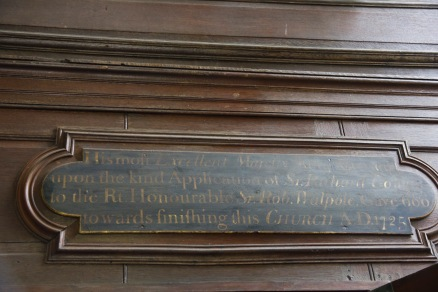 """This plaque erected when St. Philip's Cathedral, Birmingham was just a humble parish church, remembers the """"assistance"""" that Robert Walpole, the first and so far longest serving British Prime Minister, rendered in getting the church built in the early 18th Century."""