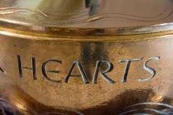 """The word """"hearts"""" forms part of a larger inscription on the font used for baptisms at St. Philips' Cathedral, Birmingham."""