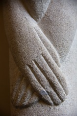 Close up of a heavily stylised contemporary religious sculpture decorating the wall in St. Philips' Cathedral, Birmingham.