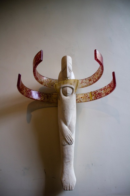 A heavily stylised contemporary religious sculpture decorating the wall in St. Philips' Cathedral, Birmingham.