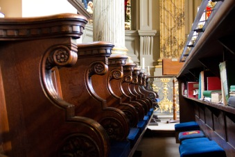 The pews near the altar where the choir sits in St. Philips' Cathedral, Birmingham.