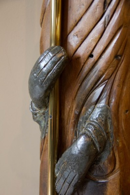 Close up of a heavily stylised modern religious sculpture decorating the wall in St. Philips' Cathedral, Birmingham.