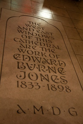 Commemorative plaque celebrating Edward Burne-Jones' stained windows in St. Philips' Cathedral, Birmingham.