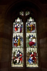 Stained glass window illustrating charity at Edgbaston Old Church.