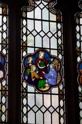 Small stained glass window showing the acts of Jesus, Edgbaston Old Church.