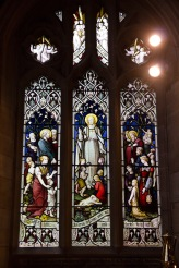 Stained glass window of people, both on earth and in heaven, gathered around Jesus, Edgbaston Old Church.