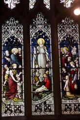 People gather around Jesus, stained glass window in Edgbaston Old Church.