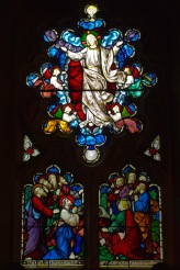 Jesus ascends to heaven. Stained glass window at Edgbaston Old Church.