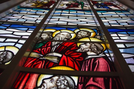 Modern stained glass window showing the disciples watching Jesus ascend to heaven in St. Catherine of Sienna Church, central Birmingham.