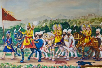 Warriors are very important in Sikhism. This is because of their historic status in India as an (at times) embattled minority. These ones are painted on the Gudwara wall. The lead soldier is carrying a Sikh standard.