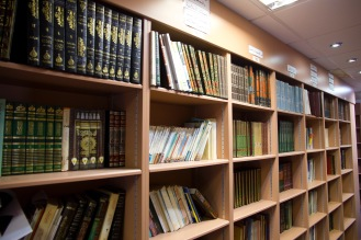 An extensive array of books on the library shelves at Birmingham Central Mosque.
