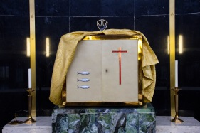 """A large decorative tabernacle on the main altar at the Catherine of Sienna Roman Catholic church, central Birmingham. The tabernacle is a sacred repository for the storage of the """"host"""" used during mass. In Roman Catholicism, perhaps more so than other branches of the Christian faith, the host is of crucial importance to worship because it is believed that during the service it takes on the literal form of the body of Christ."""