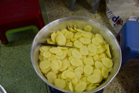 A bowl of chopped potatoes stands in the Gudwara's kitchen.