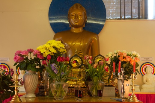 The Ladywood Pagoda's large Buddha and the decorations that surround it.