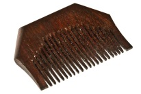 "A Kangha comb. It symbolises neatness and cleanliness reminding believers that they strive for these qualities in their lives. In Sikhism it represents one of the ""five articles of faith""."