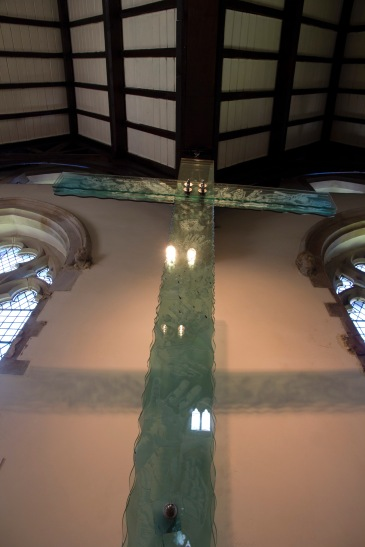 This frosted glass crucifix is an example of the kind of contemporary religious art that can be found in churches like St. John's Church, Ladywood.