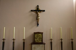 "A small crucifix stands over a small, yet ornate tabernacle in a side chapel at Catherine of Sienna Roman Catholic church, central Birmingham. A tabernacle is a box where priests place the ""host"" (special bread, which Roman Catholics believe is imbued with the literal physical body of Christ)."
