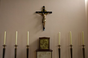 """A small crucifix stands over a small, yet ornate tabernacle in a side chapel at Catherine of Sienna Roman Catholic church, central Birmingham. A tabernacle is a box where priests place the """"host"""" (special bread, which Roman Catholics believe is imbued with the literal physical body of Christ)."""