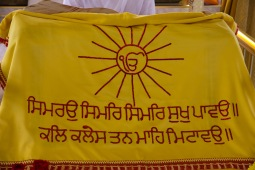 A religious banner decorating the altar at the Gudwara. It signifies that there is only one God.