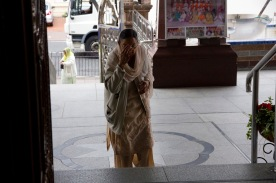 A worshiper enters the Gudwara.