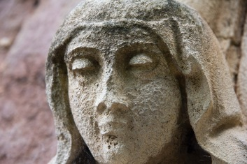 The carved-and now quite weathered-face of a young woman (possibly Mary), decorates the exterior of St. John's Church, Ladywood.