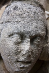 The carved-and now quite weathered-face of a youth decorates the exterior of St. John's Church, Ladywood.