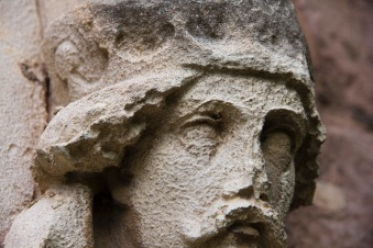 The carved-and now quite weathered-face of a king decorates the exterior of St. John's Church, Ladywood.