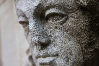 The carved-and now quite weathered-face of a learned man decorates the exterior of St. John's Church, Ladywood.
