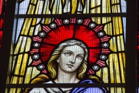 Modern stained glass window showing Mary the Mother of Jesus in St. Catherine of Sienna Church, central Birmingham.