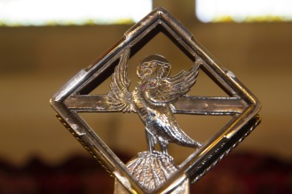 The ornate cross on the altar at St. John's Church, Ladywood, contains a small icon of an eagle signifying that Christians should look unblinkingly at the word of God.