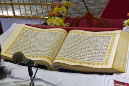 Sikh scripture lies open during the ceremony.