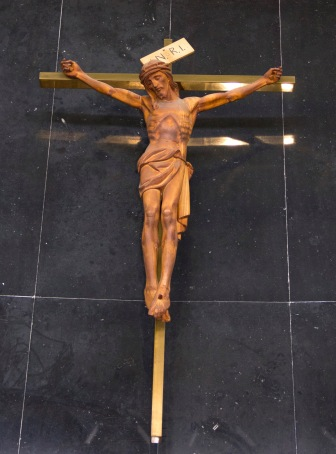 A traditional crucifix, reminding worshipers to reflect upon the suffering of Christ. It is found inside the Catherine of Sienna Roman Catholic church, central Birmingham.