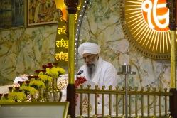 Leading worship at the Gudwara.