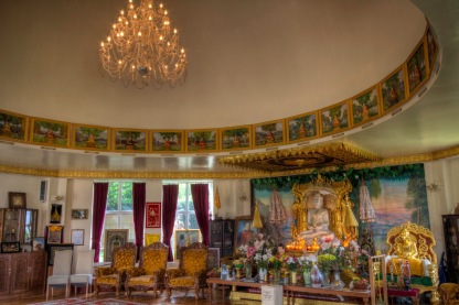 """Large """"enthroned"""" Buddha on shrine in the main room of the Ladywood Pagoda."""