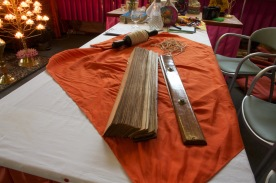 A sacred text lies unbound on a table in the Ladywood Pagoda.