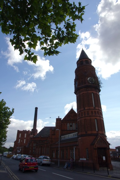 External shot of the Green Lane Mosque. Its origins as a local government building (it was built a swimming baths and public library) are still easy to discern. It was built by Martin and Chamberlain, the noted architects of many of Birmingham's distinctive red brick municipal buildings between 1893-1902.