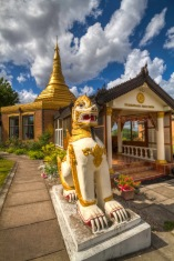 The entrance, gold dome and one of the dragon carvings at Ladywood Pagoda.