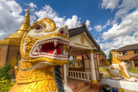 Close up shot of the entrance to Ladywood Pagoda. It is flanked by two brightly painted dragon carvings.