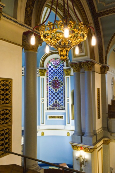 A close angled shot showing the scale and the intricacy of the decoration in Singers Hill synagogue.