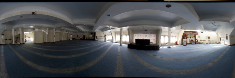 Panoramic shot showing every aspect of the prayer hall in Green Lane Mosque, Birmingham