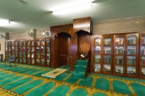 Prayer leaders seat, set amongst bookcases, at Birmingham Central Mosque