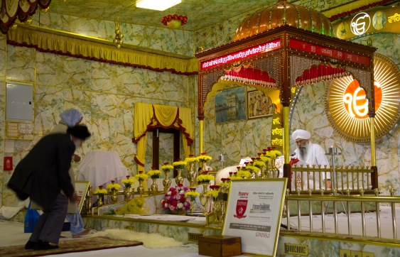 Worshipers approach the altar at the Gudwara.