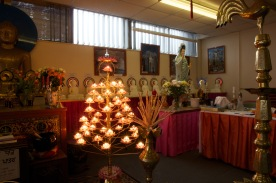 A dense aray of icons surrounds the large Buddah in the Ladywood Pagoda