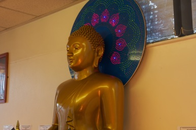 A large Buddha statue is a centerpiece of the altar display in the Ladywood Pagoda.