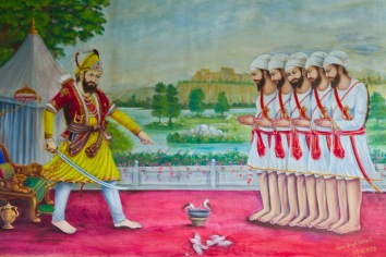 Warriors are very important in Sikhism. This is because of their historic status in India as an (at times) embattled minority. These ones are painted on the Gudwara wall.